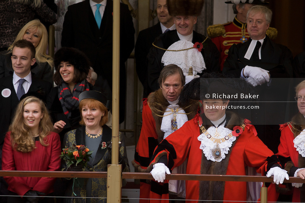 Alderman and Rt Hon The Lord Mayor of London, Roger Gifford with wife and Mayoress Claire and daughter Thea, a merchant banker with Swedish bank SEB during the Lord Mayor's Show. He is the 685th in the City of London's ancient history. The new Mayor's procession consists of a 3-mile, 150-float parade of commercial and military organisations going back to medieval times. This is the oldest and longest civic procession in the world that has survived the Plague and the Blitz, today one of the best-loved pageants. Henry Fitz-Ailwyn was the first Lord Mayor (1189-1212) and ever since, eminent city fathers (and one woman) have taken the role of the sovereign's representative in the City - London's ancient, self-governing financial district. The role ensured the King had an ally within the prosperous enclave.