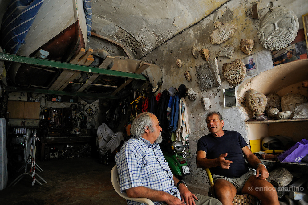 Atrani, the atelier of Lello Criscuolo (right), is a village's meeting place. Lello, a marble-cutter, is famous along Amalfi Coast for his strenght. Atrani, just 700 meters from Amalfi  is the only town preserving its character of fishermen village.