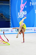 Vladinova Neviana during final at ribbon in Pesaro World Cup 03 April 2016. Neviana is a gymnast from Bulgaria. She is born in Pleven February 23, 1994. Her dream is to win a medal at the 2020 Olympic Games in Tokyo.