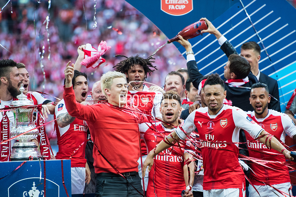 Arsenal midfielder Mohamed Elneny (35), Arsenal midfielder Alex Oxlade-Chamberlain (15), Arsenal defender Nacho Monreal (18) dcelebrate winning  the The FA Cup Final match between Arsenal and Chelsea at Wembley Stadium, London, England on 27 May 2017. Photo by Sebastian Frej.