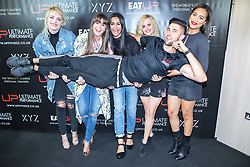 © Licensed to London News Pictures . 31/07/2017 . Manchester , UK . Coronation Street actors Katie McGlynn , Brooke Vincent ,  Sair Khan, Tina O'Brien and Tisha Merry hold up personal trainer Justin Pena at the opening event for Up Gym in Spinningfields . Photo credit : Joel Goodman/LNP