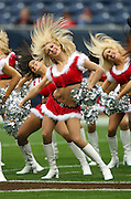 Houston Texans cheerleaders wearing Christmas outfits flip their hair during a pregame dance routine during the NFL football game against the Seattle Seahawks on December 13, 2009 in Houston, Texas. The Texans won the game 34-7. ©Paul Anthony Spinelli