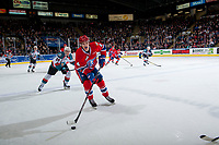 KELOWNA, CANADA - JANUARY 10: Kyle Topping #24 of the Kelowna Rockets pursues Jeff Faith #4 of the Spokane Chiefs as he skates with the puck over the blue line on January 10, 2017 at Prospera Place in Kelowna, British Columbia, Canada.  (Photo by Marissa Baecker/Shoot the Breeze)  *** Local Caption ***