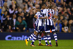 West Brom Forward Saido Berahino celebrates scoring a goal with Midfielder Youssuf Mulumbu during the second half of the match - Photo mandatory by-line: Rogan Thomson/JMP - Tel: 07966 386802 - 25/09/2013 - SPORT - FOOTBALL - The Hawthorns - West Bromwich Albion v Arsenal - Capital One Cup Round 3.