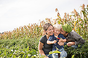 Sarah, Conner and Wendell capture some family time in their vegetable field at Diggin Roots Farm.