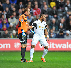 Swansea City's Ashley Williams shares a joke with Swansea City's Gerhard Tremmel after having to change his shirt due to clashing with Manchester City's away kit. - Photo mandatory by-line: Alex James/JMP - Tel: Mobile: 07966 386802 01/01/2014 - SPORT - FOOTBALL - Liberty Stadium - Swansea - Swansea City v Manchester City - Barclays Premier League