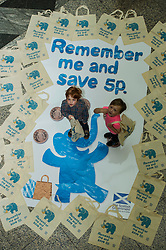 Environment minister Richard Lockhead launced a new public awareness campaign ahead of the introduction of a 5p charge for each single use carrier bag given to shoppers. Pictured Oscar Murray (aged 4) and Isaac Lee (aged 3). Edinburgh,  25 September 2014 Ger Harley | StockPix.eu