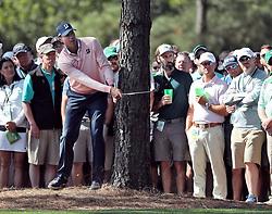 April 6, 2018 - Augusta, GA, USA - Matt Kuchar hits out of the woods off of the first fairway during the second round of the Masters Tournament Friday, April 6, 2018, at Augusta National Golf Club on Friday, April 6, 2018, in Augusta, Ga. (Credit Image: © Jason Getz/TNS via ZUMA Wire)