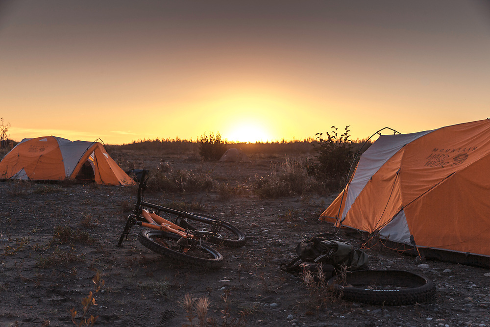 Bikes and tents are pictured at camp on the last day of the making of Riding The Tatshenshini in Dry Bay, Alaska on September 10, 2016.