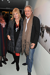 PATTIE BOYD and ROD WESTON at a private view of Bill Wyman - Reworked held at the Rook & Raven Gallery, 7 Rathbone Place, London W1 on 26th February 2013.
