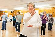 Seniors practice Tai Chi during a class at the Heineberg Senior Center in Burlington. Photographer in Burlington VT, Oliver Parini Photography.