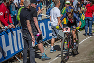 Kate Courtney (USA) goes through the feed zone during the Cross Country Olympics event at the 2018 UCI MTB World Championships - Lenzerheide, Switzerland