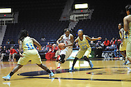 "Ole Miss guard Erika Sisk (5) drives the lane against Southern University Jaguars guard Kendra Coleman (23) at the C.M. ""Tad"" Smith Coliseum in Oxford, Miss. on Thursday, November 20, 2014. (AP Photo/Oxford Eagle, Bruce Newman)"