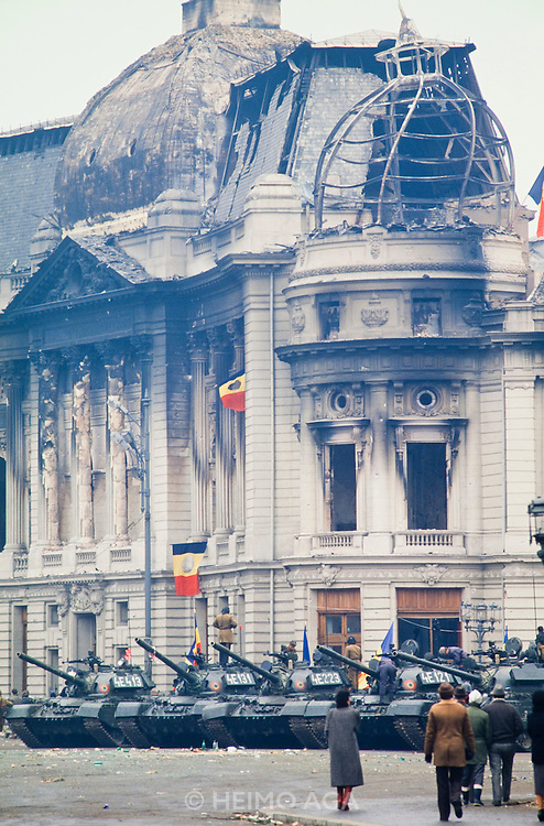 December 26, 1989. Bucharest, Rumania. The Rumanian flag with a hole instead of Communist insignia soon became the symbol of the revolution, here flying above the tanks on Revolution Square. (Photo Heimo Aga)