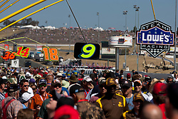 June 26, 2011; Sonoma, CA, USA;  Fans walk through the pit area before the Toyota/Save Mart 350 at Infineon Raceway.