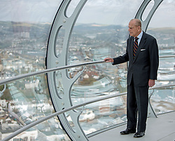 The Duke of Edinburgh looks out onto Brighton seafront during his visit to the British Airways i360 attraction in East Sussex where he took a ride on the world's first vertical cable car.