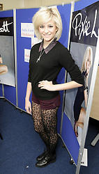 © Licensed to London News Pictures. 19/11/2011. Chislehurst, UK. Pop Star Pixie Lott visited her old Italia Conti Academy of Theatre Arts in Chislehurst, South East London today (19/11/2011). Pixie studied at the school from the age of 11. Pixie flew into Heathrow Airport this afternoon from Norway and went straight to Coopers School in Hawkwood Lane to sign copies of her new album called  ' Young Foolish Happy'. Photo credit : Grant Falvey/LNP