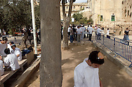 Jewish worshipers during early morning prays outside the Tomb of the Patriarchs (Ma'arat HaMachpela) during the Haye Sarah Shabbat. Thousands of Jews, and a large number of settlers, come to Hebron for the Haye Sarah during which the story of Abraham purchasing the land and cave on which stands the Tomb of the Patriarchs is read. Some six hundred Jews live in the heart of Hebron's old city surrounded by over 160,000 Palestinian inhabitants..Hebron, Israel. 03/11/2007.Photo © J.B. Russell/Blue Press