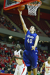 30 January 2011: Reece Uhlenhopp fres up for a lay up during an NCAA basketball game between the Drake Bulldogs and the Illinois State Redbirds. The Redbirds win in OT 77-75 after a last three point shot by Drake was ruled too late at Redbird Arena in Normal Illinois.
