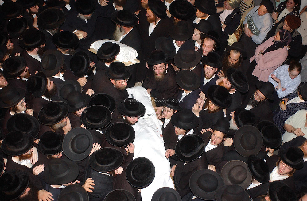 Jerusalem, Israel - Ultra Orthodox religious men carry the covered bodies of Goldie Taubenfeld and her three month old son, Shmuel, during thier funeral in jerusalem on August 20, 2003.  Goldie and her son, residents of New Square, NY, were killed in yesterday's Palestinian suicide bombing in Jerusalem..photo by Guilad Kahn/Flash90