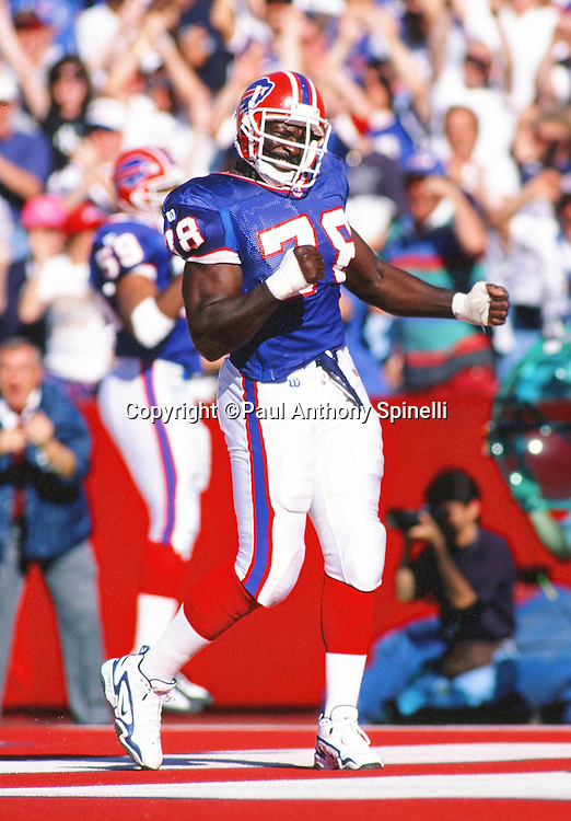 Buffalo Bills defensive end Bruce Smith (78) pumps his fists in celebration during the NFL football game against the Detroit Lions on Oct. 5, 1997 in Orchard Park, N.Y. The Bills won the game 22-13. (©Paul Anthony Spinelli)