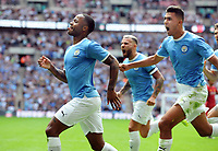 Football - 2019 FA Community Shield - Liverpool vs. Manchester City<br /> <br /> Raheem Sterling of Man City celebrates his first half goal, with Rodrigo at Wembley Stadium.<br /> <br /> COLORSPORT/ANDREW COWIE