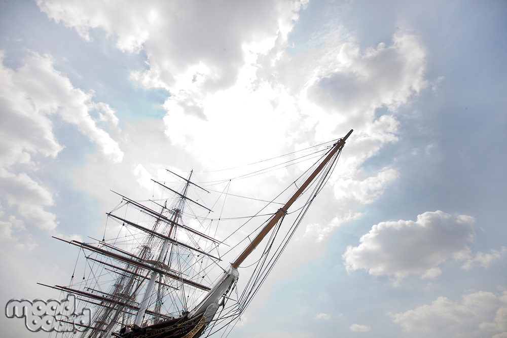 Low angle view of three masted ship against cloudy sky