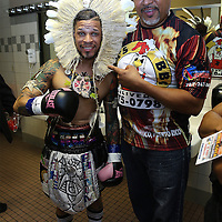 "Orlando ""El Fenomeno""  Cruz (L) poses with his outfit on prior to his match against  Gabino ""Flash"" Cota during the Boxeo Telemundo WBO/NABO Super Featherweight bout on Friday, October 9, 2015 at the Kissimmee Civic Center in Kissimmee, Florida. Cruz, who is from Puerto Rico, is the first ever openly gay boxer  in the history of the sport and won the bout by unanimous decision.  (Alex Menendez via AP)"