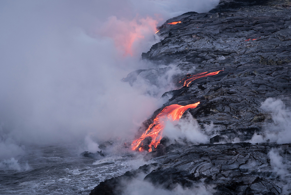 Lava from Pu'u O'o eruption entering the ocean; Hawaii Volcanoes National Park, Island of Hawaii.