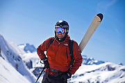 SHOT 3/12/10 2:34:22 PM - Doug Pensinger of Denver, Co. pauses to listen to the guides instructions while hiking the ridgeline at Silverton Mountain in Silverton, Co. Skiing and snowboarding at Silverton Mountain in Silverton, Co. Silverton Mountain is unique amongst ski resorts requiring a guide (most of the season), avalanche gear and limiting the number of daily visitors. There are multiple bowls, chutes, cliffs and natural terrain features to be discovered during a visit to Silverton Mountain. It is the highest Ski Area in North America with a peak of 13,487' and it is also the steepest with no easy way down. The mountain is left in it's natural state with the exception of the avalanche reduction work which occurs. There is only one chair at the mountain though most skiiers and snowboarders will end up hiking in various directions at the top. The mountain also features heliskiing trips for $159 a trip (at the time of visit). The mountain opened in 2002. (Photo by Marc Piscotty / © 2010)