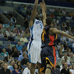 05 October 2008:  New Orleans Hornets center Melvin Ely (33) shoots over Golden State Warriors forward Anthony Randolph (4) during a NBA preseason game between the Golden State Warriors and the New Orleans Hornets at at the New Orleans Arena in New Orleans, LA..