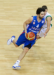 Milos Teodosic of Serbia vs Jaka Lakovic of Slovenia during basketball game between National basketball teams of Slovenia and Serbia in 7th place game of FIBA Europe Eurobasket Lithuania 2011, on September 17, 2011, in Arena Zalgirio, Kaunas, Lithuania. Slovenia defeated Serbia 72 - 68 and placed 7th. (Photo by Vid Ponikvar / Sportida)