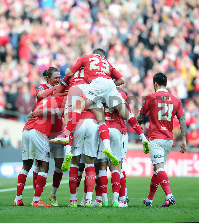 Bristol City's Aden Flint celebrates with Bristol City team mates   - Photo mandatory by-line: Joe Meredith/JMP - Mobile: 07966 386802 - 22/03/2015 - SPORT - Football - London - Wembley Stadium - Bristol City v Walsall - Johnstone Paint Trophy Final