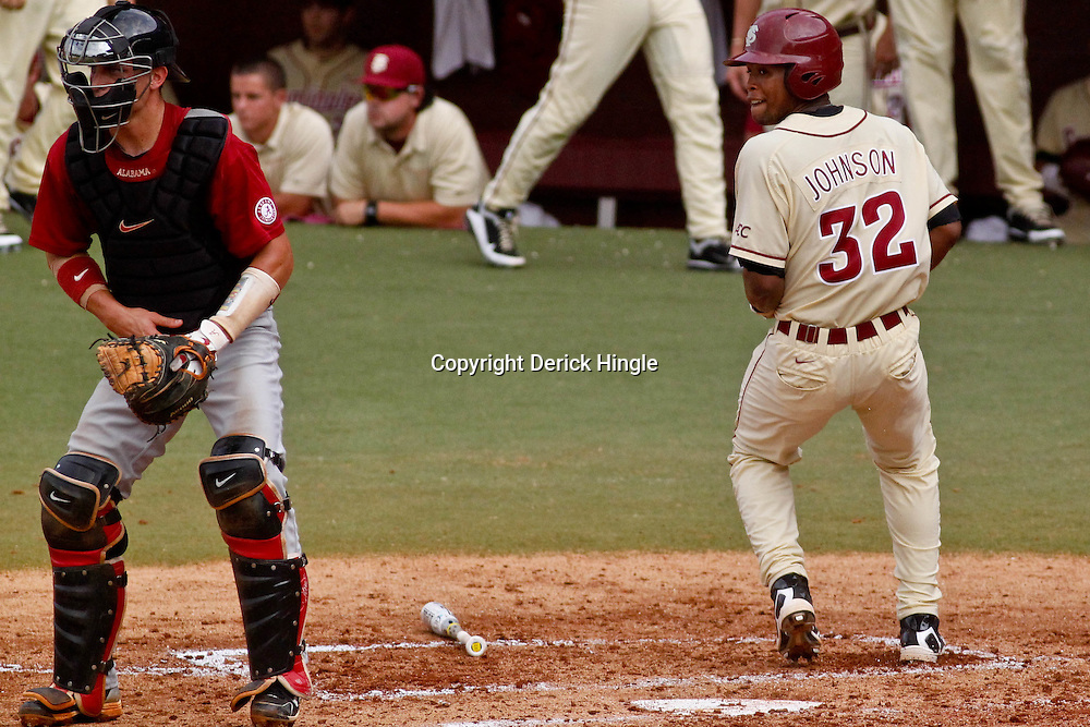 June 05, 2011; Tallahassee, FL, USA; Florida State Seminoles third baseman Sherman Johnson (32) scores against the Alabama Crimson Tide during the second inning of the Tallahassee regional of the 2011 NCAA baseball tournament at Dick Howser Stadium. Mandatory Credit: Derick E. Hingle
