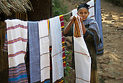 Ethiopia Lake Tana Zege Peninsula, woman selling hand woven cloth to tourists
