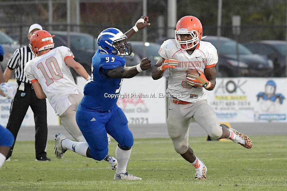 Orange City University running back Lorenzo Lingard (3) rushes for yardage past Apopka defensive lineman Curtis Williams (95) during the first half of a spring high school football game in Apopka, Fla., Thursday, May 25, 2017. (Photo by Phelan M. Ebenhack)