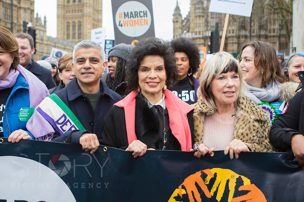 UNITED KINGDOM, London: 04 March 2018 London Mayor Sadiq Khan (left) and Bianca Jagger(centre) join thousands of supporters during the #March4Women rally in London this afternoon. Thousands of people marched from Parliament to Trafalgar Square to celebrate International Women's Day and 100 years since the first women in the UK gained the right to vote. <br /> Rick Findler / Story Picture Agency