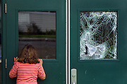 Fire does about $1 million in damages to Oliver P. Lent Elementary School. Amanda Snyder, 7, is a second grader there and checks to see what she can see inside. It is unclear whether the window was broken by the possible arsonist or by police/fire units responding.