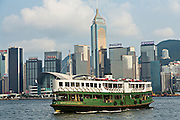 Star Ferry crossing Victoria Harbour with Central District in the background Hong Kong.