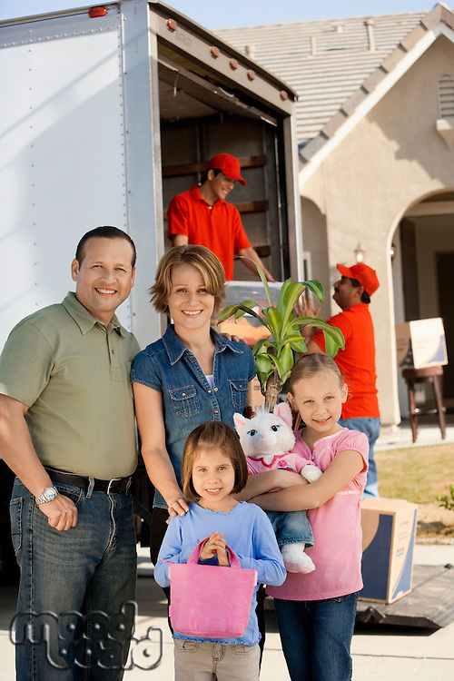 Family in front of removal van and house portrait