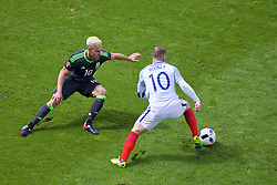 LENS, FRANCE - Thursday, June 16, 2016: Wales' Aaron Ramsey in action against England's Wayne Rooney during the UEFA Euro 2016 Championship Group B match at the Stade Bollaert-Delelis. (Pic by Paul Greenwood/Propaganda)