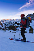 Backcountry skier enjoying the last light below Piute Pass, Inyo National Forest, Sierra Nevada Mountains, California