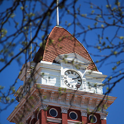 Courthouse clock tower on the Lake County Courthouse in Crown Point Indiana. The Lake County Courthouse was built in 1878 and is nicknamed The Grand Old Lady. The courthouse architecture is Romanesque and Georgian. Today it's used for events and has a ballroom and restaurants.
