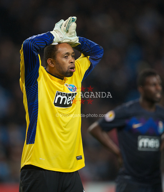 MANCHESTER, ENGLAND - Wednesday, February 22, 2012: FC Porto's goalkeeper Helton looks dejected as his side lose 4-0 to Manchester City during the UEFA Europa League Round of 32 2nd Leg match at City of Manchester Stadium. (Pic by David Rawcliffe/Propaganda)