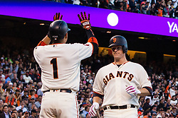 SAN FRANCISCO, CA - JULY 26: Matt Cain #18 of the San Francisco Giants is congratulated by Ramiro Pena #1 after hitting a three run home run against the Cincinnati Reds during the second inning at AT&T Park on July 26, 2016 in San Francisco, California.  (Photo by Jason O. Watson/Getty Images) *** Local Caption *** Matt Cain; Ramiro Pena