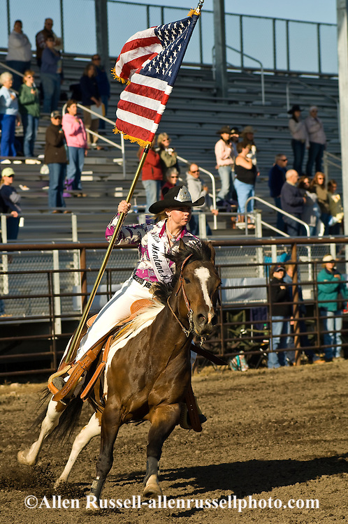 Montana High School Rodeo Finals, Carly Sykes, Rodeo Queen carries American Flag in Grand Entry, Bozeman, Montana, Paint Horse