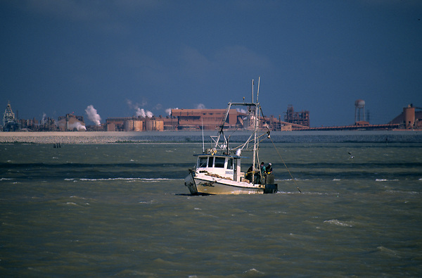 Oyster boat in front of the Alcoa plant in Lavaca Bay