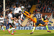 Fulham goalkeeper Sergio Rico (25) saves a header from Manchester City defender Nicolas Otamendi (30) during the Premier League match between Fulham and Manchester City at Craven Cottage, London, England on 30 March 2019.