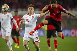 March 21, 2019 - Vienna, Austria - Krzysztof Piatek of Poland fights with Aleksandar Dragovic of Austria during the UEFA European Qualifiers 2020 match between Austria and Poland at Ernst Happel Stadium in Vienna, Austria on March 21, 2019  (Credit Image: © Andrew Surma/NurPhoto via ZUMA Press)
