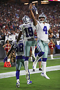 Dallas Cowboys wide receiver Brice Butler (19) celebrates by doing a fake layup with Dallas Cowboys quarterback Dak Prescott (4) after Butler catches a 37 yard touchdown pass thrown by Dallas Cowboys quarterback Dak Prescott (4) for a 21-14 third quarter Cowboys lead during the 2017 NFL week 3 regular season football game against the against the Arizona Cardinals, Monday, Sept. 25, 2017 in Glendale, Ariz. The Cowboys won the game 28-17. (©Paul Anthony Spinelli)